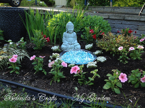 the irises astible sedum hosta and japanese painted ferns were already in the garden so i just popped in some annuals for a blast of color - Buddha Garden