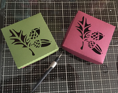 top view of boxes with acorn pattern cut out.